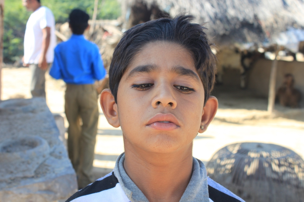 "... according to Deepak, this boy is ""mentally disabled"" , but he insisted I take his picture. This is his serious pose. Then he asked to take my picture so I gave him the camera and showed him how to use it. First he pointed it at me, then he thought he would shoot his friend instead ......"